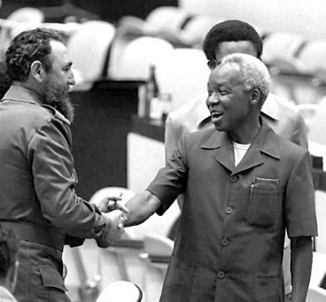 Julius nyerere greets cuban president fidel castro